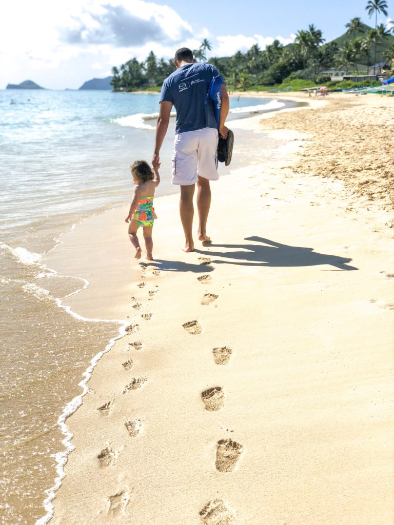 father daughter on hawaii beach